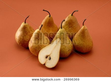 Group uf pears on orange background.Cut pear.Half pear. poster