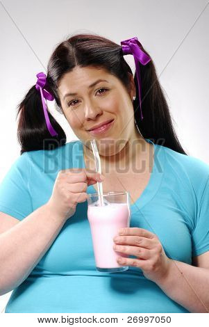 fat woman drinking strawberry diet milkshakes.young girl drinking strawberry milkshakes