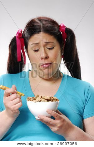 Fat woman holding a cereal bowl, woman eating cereal bowl,fat woman doing diet.