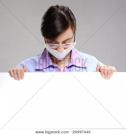 medical surgeon holding a white card. Doctor holding a white card.
