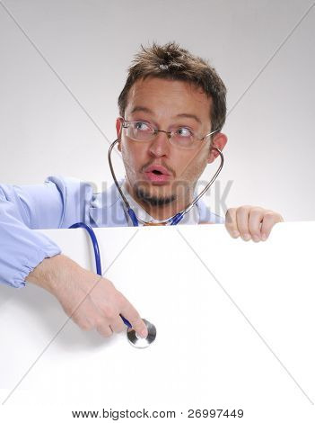 A doctor usin a Stethoscope over a white card. Doctor stethoscope.