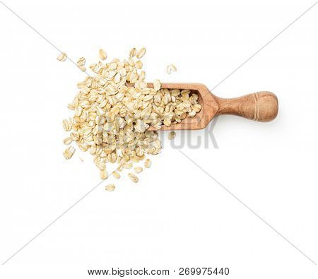 Oat flakes in scoop on white background