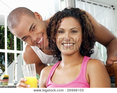 Afro american couple in a kitchen. poster