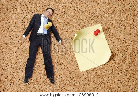 businessman and push pin on bulletin board.
