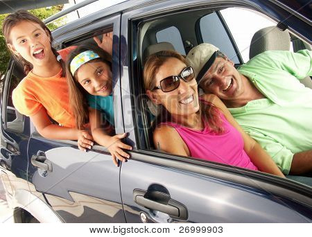 Hispanic family in a car.
