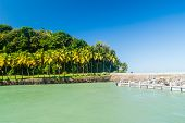 Pier at Ile Royale, one of the islands of Iles du Salut Islands of Salvation in French Guiana. poster