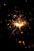 closeup view of burning sparkler poster