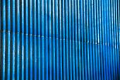 A blue urban background of repetitive patterns poster