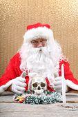 Santa Claus. Santa Crime Scene. Santa Claus holds a Human Skull for an unexpected Evil Santa Photo Shoot. Crime Scene do not cross.  poster
