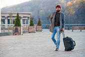 Hipster ready enjoy travel. Looking for accommodation. Man bearded hipster travel with big luggage bag wait for taxi bring him to hotel. Travel tips. Traveler with suitcase arrive travel destination. poster