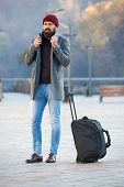 Looking for accommodation. Man bearded hipster travel with big luggage bag wait for taxi bring him to hotel. Travel tips. Traveler with suitcase arrive travel destination. Hipster ready enjoy travel. poster