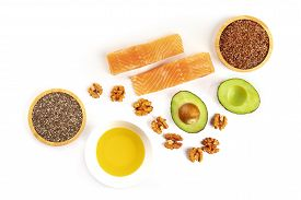 An Overhead Photo Of The Ingredients Of A Healthy Omega 3 Diet. Salmon, Avocado, Nuts, Chia And Flax