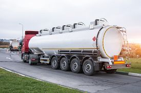 Fuel Truck Waiting In Line For Unloading At A Fuel Automobile Refueling.