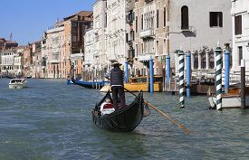 Gondola And Boat On The Grand Canal In Venice, Italy.