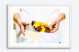 Male Hands Holding A Gift Box. Opened Present Wrapped With Ribbon And Bow. Christmas Or Birthday Pac