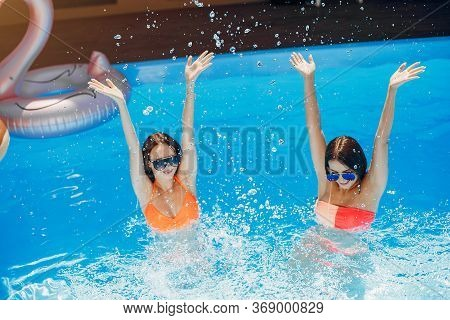 Girls On Summer Party In The Swimming Pool