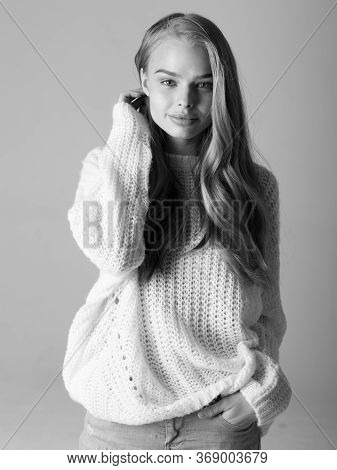 Black And White Fashion Photo Of A Beautiful Model On A City Street. A Cheeky Girl In A Black Leathe