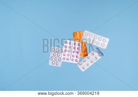 Medications For The Treatment Of Cold, Flu And Liquid On A Blue Background.various Tablets And Capsu