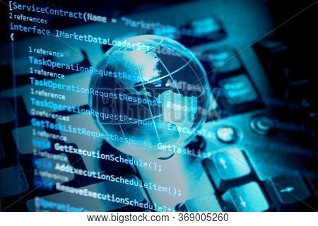 Programming Code, World Transparent Globe Earth On Computer Keyboard. Global Communications Business