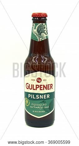 Gulpen, The Netherlands - May 29, 2020: Bottle Of Gulpener Pilsener Beer Against A White Background.