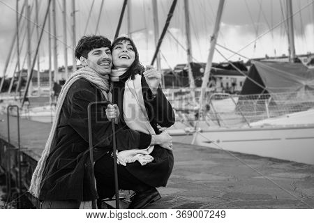 Two Lovers In A Harbor On The Lake. Black And White Photography.