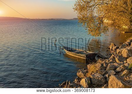 Picturesque Colorful Autumn Landscape Calm Water Rocky Coast Line Of Country Side Lake With Empty Lo