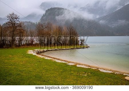 Calm Autumn Landscape Peaceful Lake Waters Shore Line Scenic View Bare Trees And Morning Smoke Near