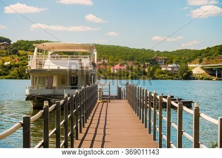 Pier With Houseboat On Reservoir. Belgorod Region, Russia.