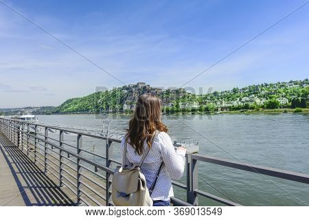 Rear View Of Woman Standing By Railing Protection On Promenade River, Lake