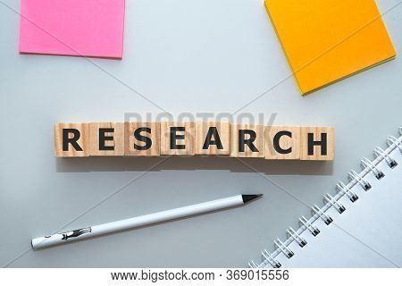 Research Word Made With Building Blocks On Office Table.