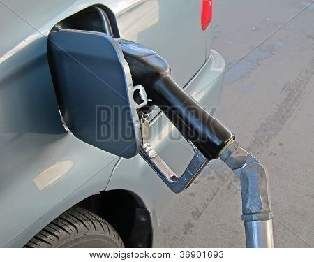 Car Getting Fueled At Gas Station