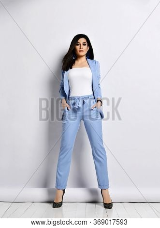 Self-confident And Charismatic Business Woman In Blue Official Suit Formal Wear Stands High-heeled S