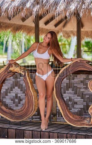 Beautiful Girl In White Bikini Posing In Bungalow