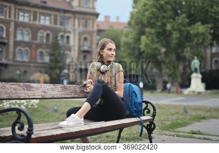 beautiful teenager on a bench