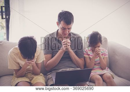 Children Praying With Father Parent With Laptop, Family And Kids Worship Online Together At Home, St