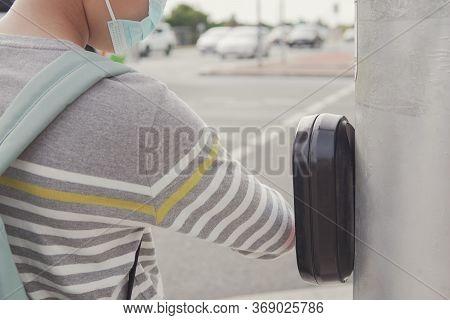 Young  Preteen Tween Teen Boy Using His Elbow Pressing Traffic Light Button Due To Covid-19 Coronavi