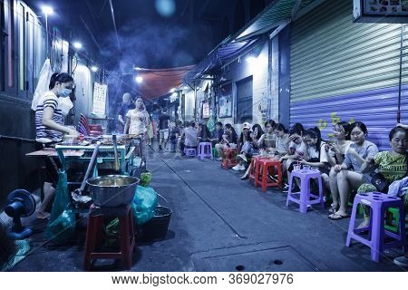Ho Chi Minh City, Vietnam - May 8, 2020: Street Food Cafe Cooking And Serving Cheap Drinks And Meat