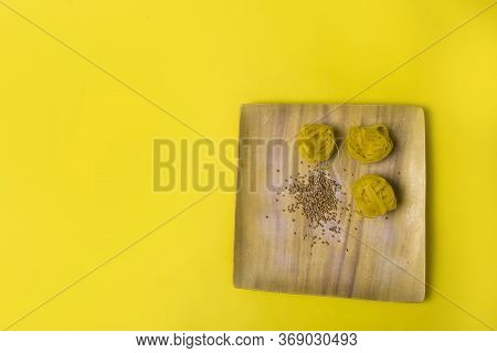 Diet And Weight Loss Theme On The Yellow Background. Buckwheat And Macaroni Products In The Wooden P