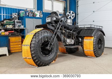 Novosibirsk/ Russia - May 12, 2020, Black Homemade Swamp Buggy In Special Mud Nozzles , Front View,