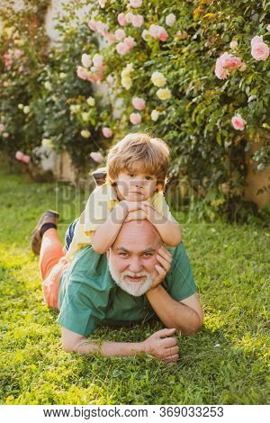Old Father Play With Son - Happy Fathers Day, Father With Son Having Fun In Park. Family Summer And