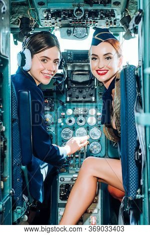 Couple Smiling Female Pilots In The Aircraft. Portrait Of Smiling Female Pilots. Looking At Camera I