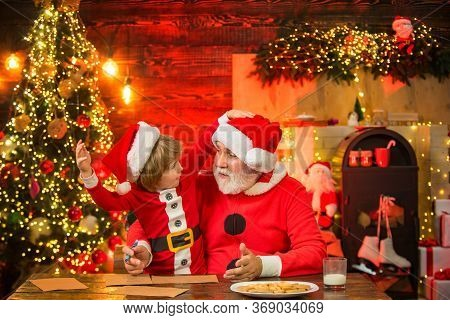 Christmas Child Son And Father Write Letter To Santa Claus. Child Boy And Grandfather Writing Christ