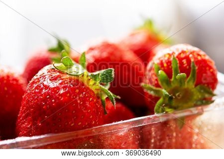 Strawberry Close-up In A Plastic Container. Fresh Juicy Flavored Strawberries In Selective Focus. Th