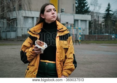 Close Up Portrait Of Hungry Girl Is Eating Fast Street Junk Food. Young Woman Biting Tasty Yummy Sha