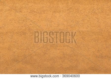 A Heterogeneous Porous Orange Wall With Many Scratches And Pits. Orange Concrete Cement Wall