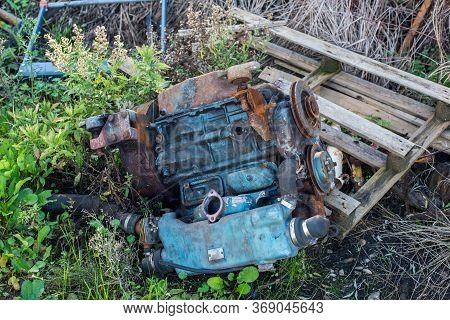 A Discarded Old Yacht Blue Diesel Engine.