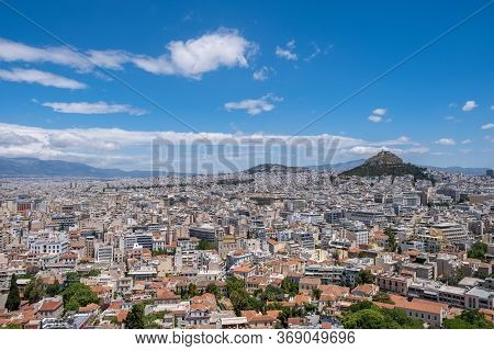 Mount Lycabettus And Athens Cityscape View From Acropolis Hill In Greece, Blue Sky, Sunny Day.