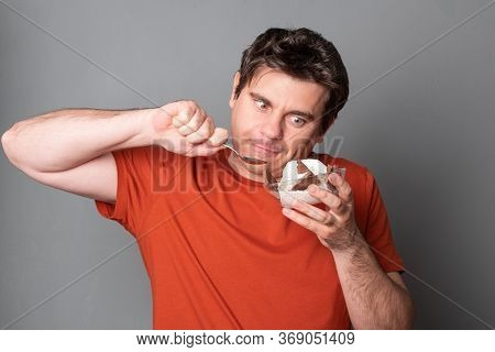 Funny Man Holds A Plate Of Chocolate Ice Cream. Fanny Man With An Appetite Eats Ice Cream.