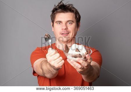 Man Holds A Plate Of Chocolate Ice Cream. Fanny Man With An Appetite Eats Ice Cream.