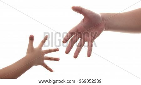 Small Child's Hand Reaches Fathers Hand Man Isolated On White Background, Parenting Love Concept